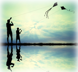 Boy Flying Kite with his father